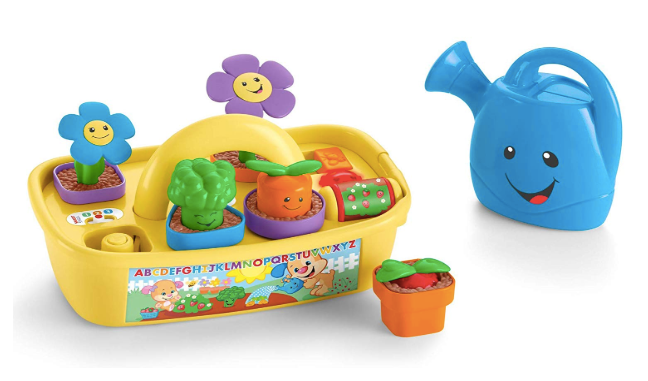 The image depicted is of the Fisher-Price Laugh & Learn Smart Stages Grow 'n Learn Garden Caddy set. Which comes complete with watering cartoon and flower pots