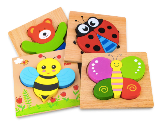 The image depicts the four wooden animal jigsaw puzzles designed by Skyfield for toddlers. The jigsaw puzzles depict the following animals: a bear, a butterfly, a bumblebee and a ladybug.