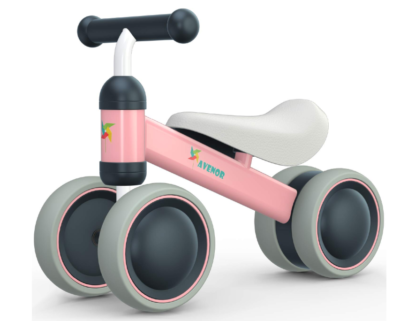 this is an image of a pink baby balance bike