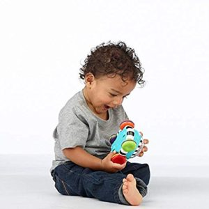 This is an image of a little boy playing with a push car toy