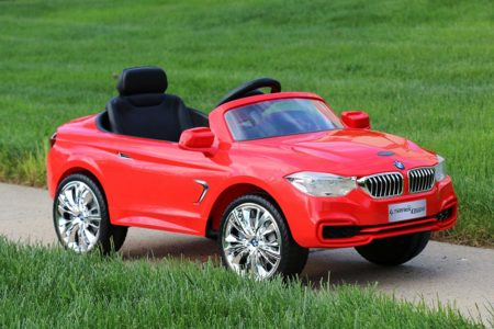 this is an image of kids bmw 4 series in red color