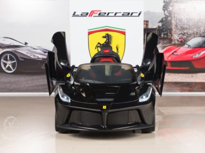 This is an image of kids ferrari powered wheels in black color