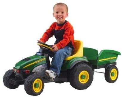This is an image of kids farm tractor and trailer by john deere in green color