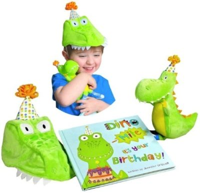 This is an image of baby dinosaur birthday gift with a book and dinosaur gift set in green color