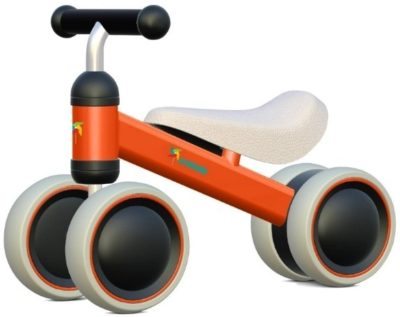 This is an image of baby bicycle in orange color and black wheels