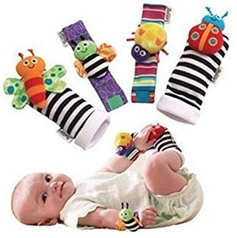 This is an image of baby soft socks with animals toys on them
