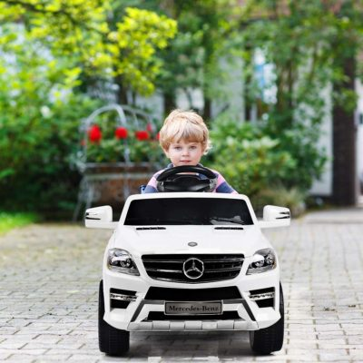 This is an image of kids mercedes truck in white color