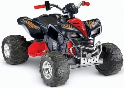 This is an image of kids power wheels hot kawazaki quad in red and black colors