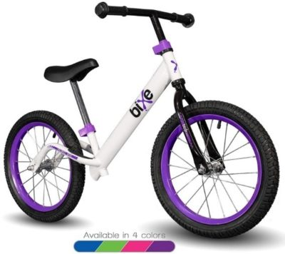 This is an image of boy's balance bike in white and purple colors