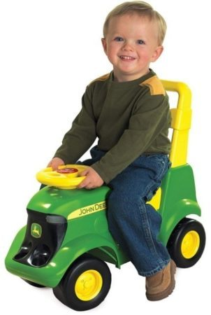 This is an image of kid's john deere tractor in green and yellow colors