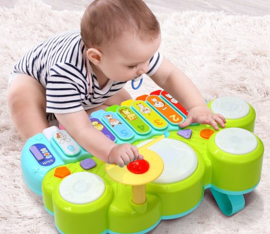 This is an image of a toddler playing with a multifunction learning toy set.