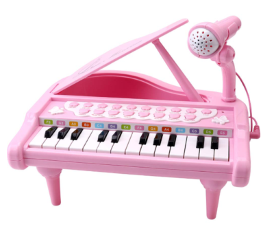 This is an image of a pink keyboard for kids.