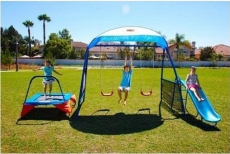This is an image of boy's outdoor with trampoline and swings and slide