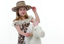This is an image of girl's ride on unicorn in white color
