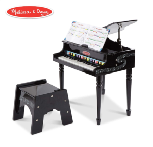 this is an image of a melissa and doug grand piano