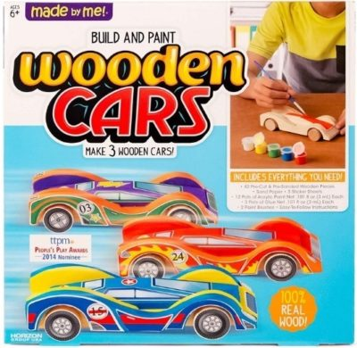 This is an image of boys building and painting wooden cars